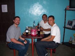 "Bart, Luis, and Juan Ramón eating ""pupusas"" at a little cafe."