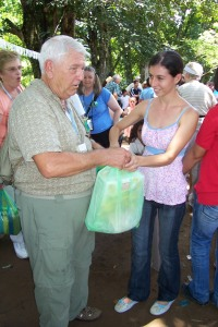 Sponsor, Darryl Rezak, distributes food provisions to mothers of sponsored families.