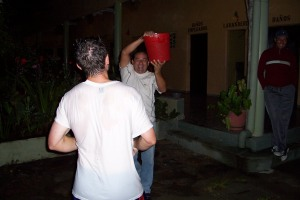 Luis tries to get Bart with a bucket of cold water (a Honduran tradition).