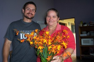 Rosie, project sewing instructor, gives Bart a bouquet of wild flowers for this birthday.