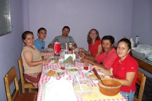 Miriam, her son, Angel Enrique, Bart, Annie, Santos, and Cindy share an italian-style spaghetti dinner to finish out the birthday celebrations.