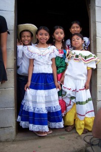 A few dancers pose for a picture before taking the stage in Tacuba.