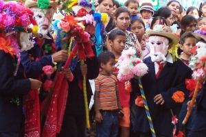 Sponsored children perform the dance of the viejitos, or little old men, in Tacuba.